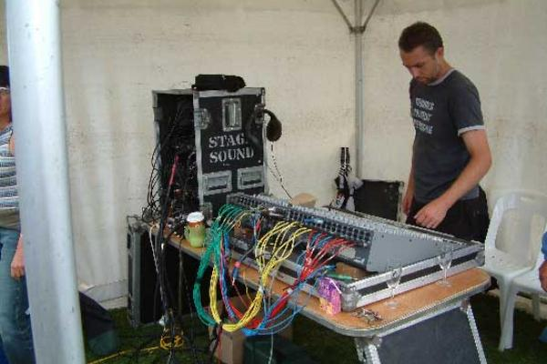 Ian engineering an outdoor concert and wondering what all those knobs are for!